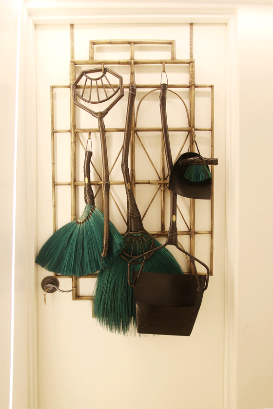 Wicked, a 7-piece cleaning set, hung over a door